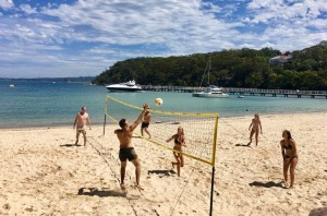 Enjoying a game of beach volleyball on the Harbour Beaches cruise