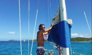 boat rentals virgin islands-captain jim adjusting the main sail