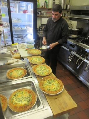 Chef preparing fresh Quiche for Lunch