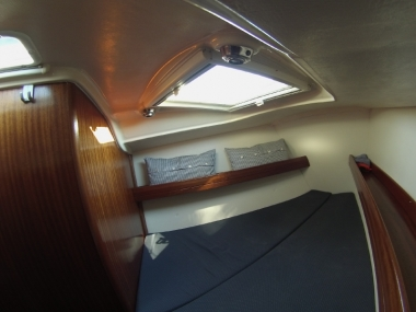 Double cabin at the bow with two portholes  on the sky