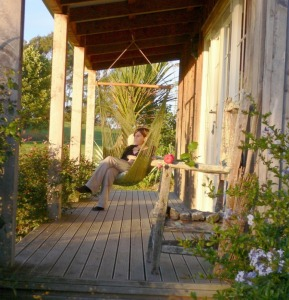 Relax on the verandah at Kamahi Cottage