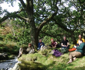 A group enjoying a picnic in a remote river valley